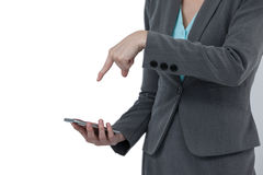 Mid section of businesswoman using mobile phone Stock Photo