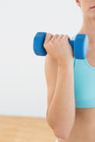 Mid section Close up of a woman with dumbbells at fitness studio Royalty Free Stock Photography