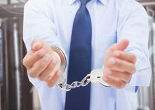 Mid section of corrupt businessman in hand cuffs. Composite image of corrupt businessman in hand cuffs Stock Image