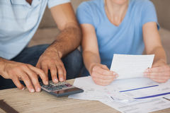 Mid section of a couple with bills and calculator Royalty Free Stock Photos