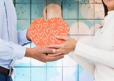 Mid-section of couple holding a gift box Royalty Free Stock Photography