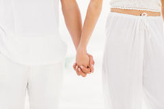 Mid section of couple holding hand Royalty Free Stock Photo
