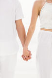 Mid section of couple holding hand Stock Photos