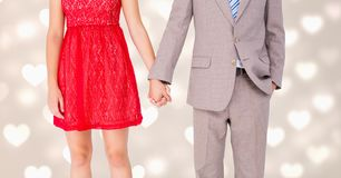 Mid-section of couple holding hands. Mid-section of romantic couple holding hands Stock Photos