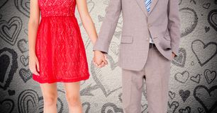 Mid-section of couple holding hands. VMid-section of couple holding hands against digitally generated heart background Stock Photo
