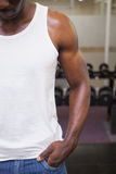 Mid section of a cropped muscular man in gym Royalty Free Stock Images