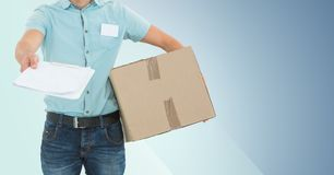 Mid section of delivery man holding parcel box and clipboard