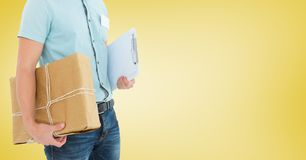 Mid section of delivery man holding parcel and clipboard Stock Photography
