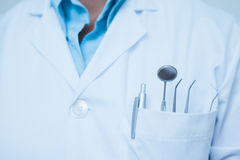 Mid section of dental tools in dentists pocket. Close up mid section of dental tools in dentists pocket Stock Image