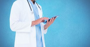 Mid section of doctor using digital tablet Royalty Free Stock Images