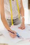 Mid section of a fashion designer working on her designs Royalty Free Stock Photo
