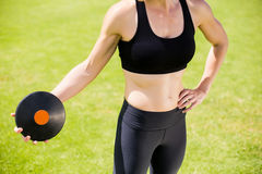 Mid section of female athlete about to throw a discus. In stadium royalty free stock photo