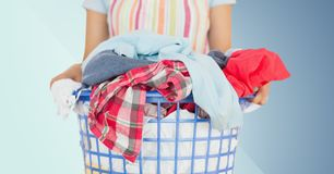 Mid section of female cleaner holding laundry Royalty Free Stock Photos