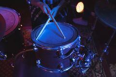 Mid section of female drummer at concert Stock Image