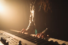 Mid section of female musician playing piano royalty free stock image