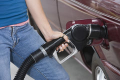 Mid Section Ff A Woman Refueling Her Car Stock Images