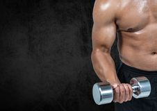 Mid section of a fit man lifting dumbbells Royalty Free Stock Image