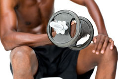 Mid section of fit shirtless man lifting dumbbell Royalty Free Stock Photography