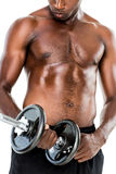 Mid section of fit shirtless young man lifting dumbbell Royalty Free Stock Image