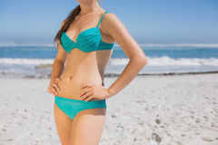 Mid section of fit woman in bikini on the beach Stock Photos