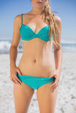 Mid section of fit woman in bikini on the beach Stock Photography