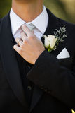 Mid section of flowers on lapel of male Stock Photos