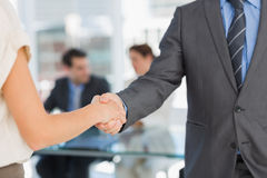 Mid section of handshake to seal a deal after meeting Stock Photography