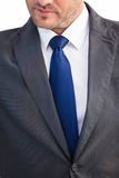 Mid section of handsome businessman frowning Royalty Free Stock Photography