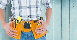 Mid-section of handy man with tool belt Royalty Free Stock Photo