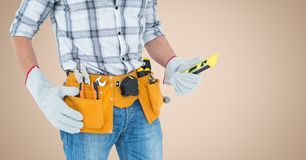 Mid-section of handy man with tool belt Stock Photography