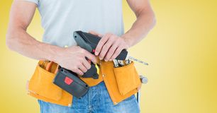 Mid-section of handy man with tool belt and drill Stock Image