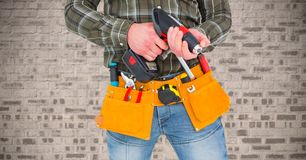 Mid section of handy man with tools and drill Royalty Free Stock Image