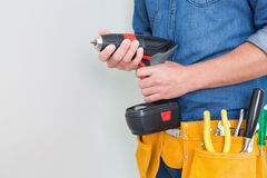 Mid section of a handyman with drill and toolbelt Stock Images