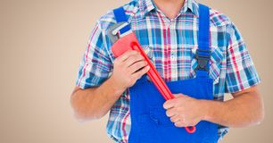 Mid section of handyman holding pipe wrench Royalty Free Stock Photos