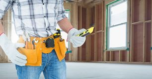 Mid section of handyman holding worktool Stock Image