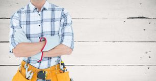 Mid section of handyman with tool belt Stock Image