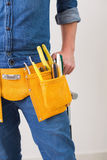 Mid section of a handyman with toolbelt Royalty Free Stock Images