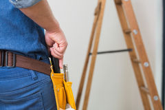 Mid section of a handyman with toolbelt Stock Image