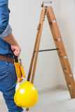 Mid section of a handyman with toolbelt and hard hat Royalty Free Stock Photography