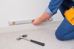 Mid section of a handyman using spirit level Royalty Free Stock Photography