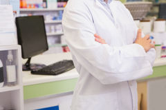 Mid section of junior pharmacist with arms crossed Royalty Free Stock Images