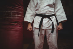 Mid section of karate player making fist Royalty Free Stock Image
