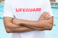 Mid section of lifeguard standing with arms crossed Royalty Free Stock Photo