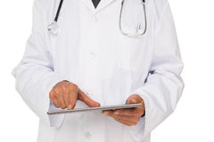 Mid section of a male doctor using digital tablet Stock Image