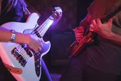 Mid section of male and female guitarist in nightclub Stock Photography