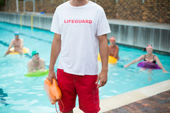 Mid section of male lifeguard at poolside Stock Photos