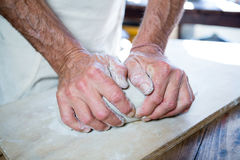 Mid section of male potter molding clay Royalty Free Stock Photography