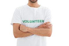 Mid section of a male volunteer with hands folded Royalty Free Stock Photos