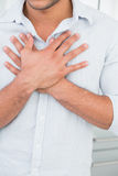 Mid section of man with chest pain Royalty Free Stock Image