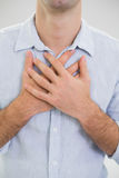 Mid section of a man with chest pain Royalty Free Stock Photography